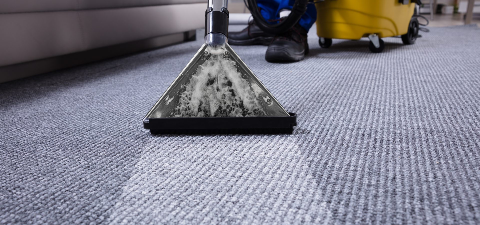 carpet cleaning machine being used to clean and office carpet