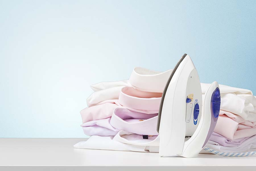 stack of freshly ironed clothes